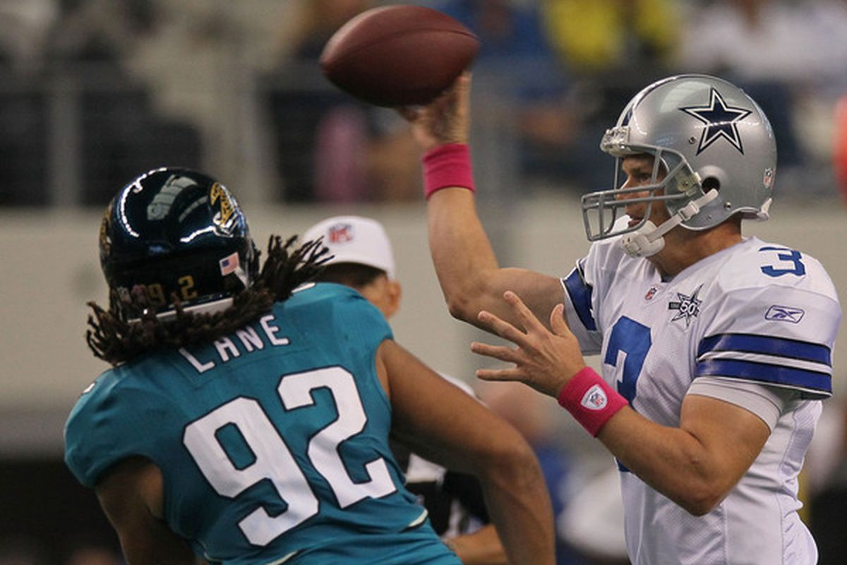 ARLINGTON TX - OCTOBER 31:  Quarterback Jon Kitna #3 of the Dallas Cowboys throws the ball in front of Austen Lane #92 of the Jacksonville Jaguars at Cowboys Stadium on October 31 2010 in Arlington Texas.  (Photo by Stephen Dunn/Getty Images)
