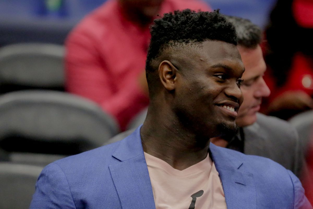 New Orleans Pelicans forward Zion Williamson sits on the bench prior to tip off against the Golden State Warriors at the Smoothie King Center.