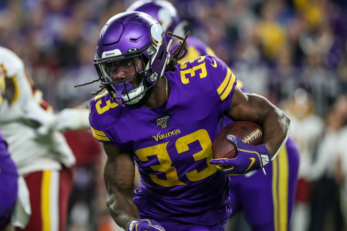 Minnesota Vikings running back Dalvin Cook (33) carries the ball during the second quarter against the Washington Redskins at U.S. Bank Stadium.