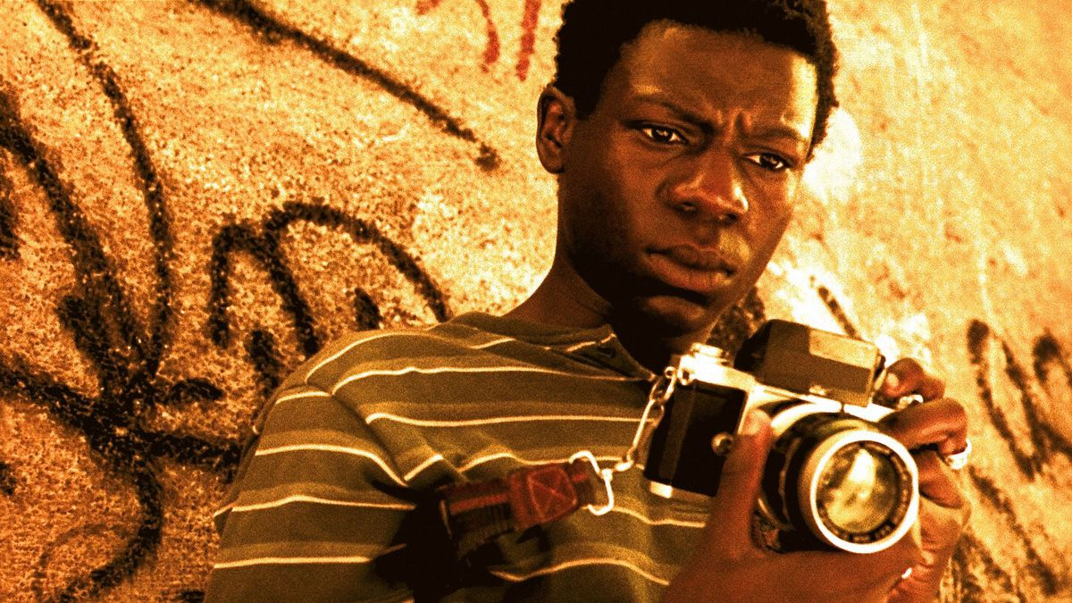 Rocket contemplating his camera in City of God.