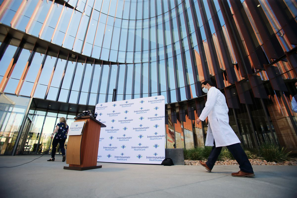 Dr. Brandon Webb, chairman of Intermountain Healthcare's COVID-19 therapeutics team, walks to the podium during a press conference at Intermountain Healthcare's Transformation Center in Murray on Tuesday, April 21, 2020. In an effort to expand access to investigative treatments for COVID-19, Intermountain Healthcare is participating in the U.S. Food and Drug Administration's newly launched National Expanded Access Treatment Protocol to allow use of convalescent plasma donated by patients who have recovered from COVID-19 to be processed and given to patients with the virus. A team of Intermountain transfusion experts arranged and conducted Utah's first plasma transfusion of a COVID-19 patient at Intermountain Medical Center.