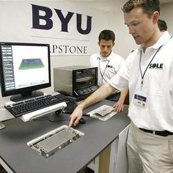 Caleb Waugh, right, and Eric Radford, students at BYU, on Tuesday demonstrate how the computer software produces a pin mold that is later used to make a customized foot insole in a fraction of the time it now takes.