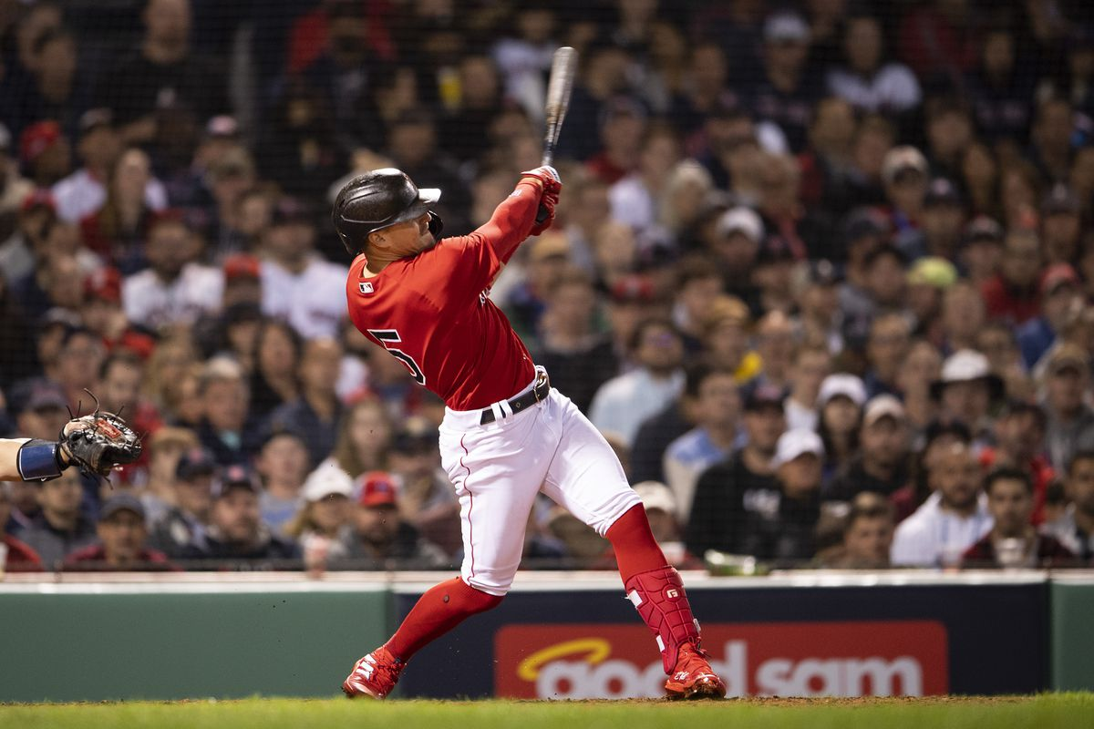 Enrique Hernandez #5 of the Boston Red Sox hits a single during the seventh inning of game four of the 2021 American League Division Series against the Tampa Bay Rays at Fenway Park on October 11, 2021 in Boston, Massachusetts.