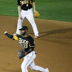 Salt Lake Bees shortstop Rey Navarro turns a double play during a game against the Las Vegas 51s at Smith's Ballpark in Salt Lake City on Monday, June 5, 2017.