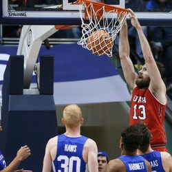 Utah Utes forward David Collette (13) dunks during the game against the Brigham Young Cougars at the Marriott Center in Provo on Saturday, Dec. 16, 2017.