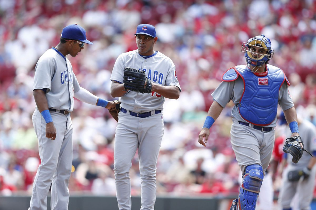 Carlos Marmol of the Chicago Cubs is encouraged by shortstop Starlin Castro against the Cincinnati Reds at Great American Ball Park in Cincinnati, Ohio. The Reds came from behind to win 4-3. (Photo by Joe Robbins/Getty Images)