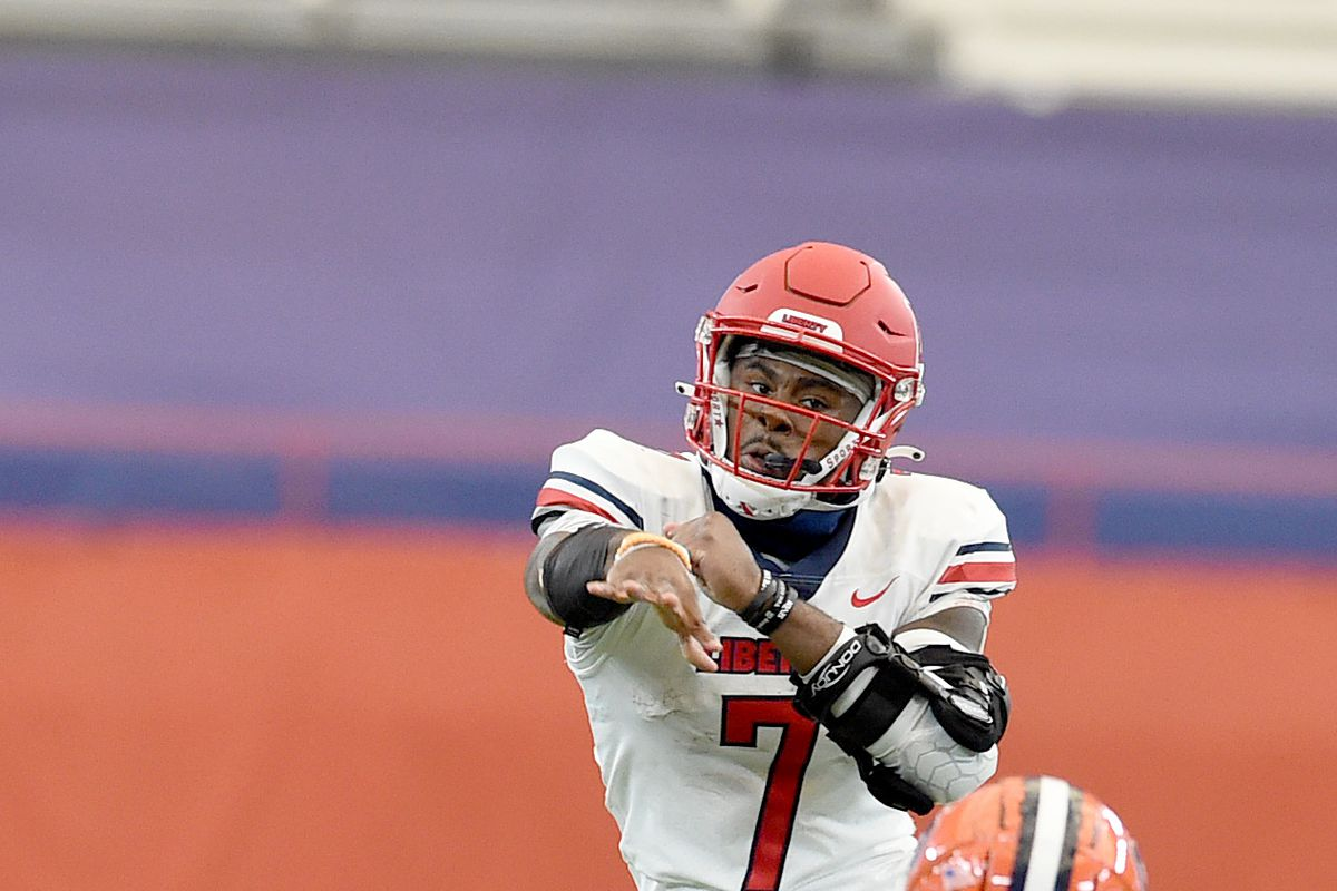 Liberty Flames quarterback Malik Willis passes over the defense of Syracuse's Syracuse Orange defensive back Robert Hanna in the second half on Saturday, Oct. 17, 2020, at the Carrier Dome in Syracuse, N.Y.