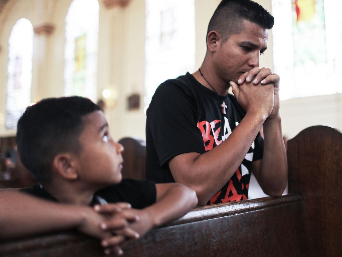 Honduran father Juan and his 6-year-old son Anthony, who fled their country and were separated at the border.