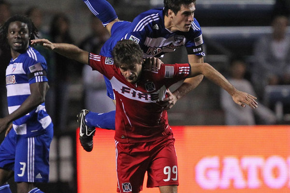 Pictured - the Chicago Fire's playoff hopes getting tackled.