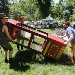 Adam Hall, Timmy the Teeth and Jake Buntjer work to get their booth set up as artists prepare for the Utah Arts Festival in Salt Lake City on Wednesday, June 21, 2017.