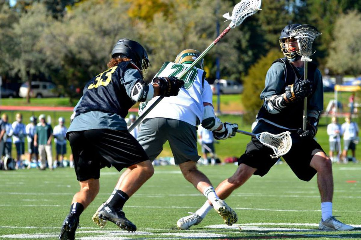 that guy is about to hit that other guy with that stick.