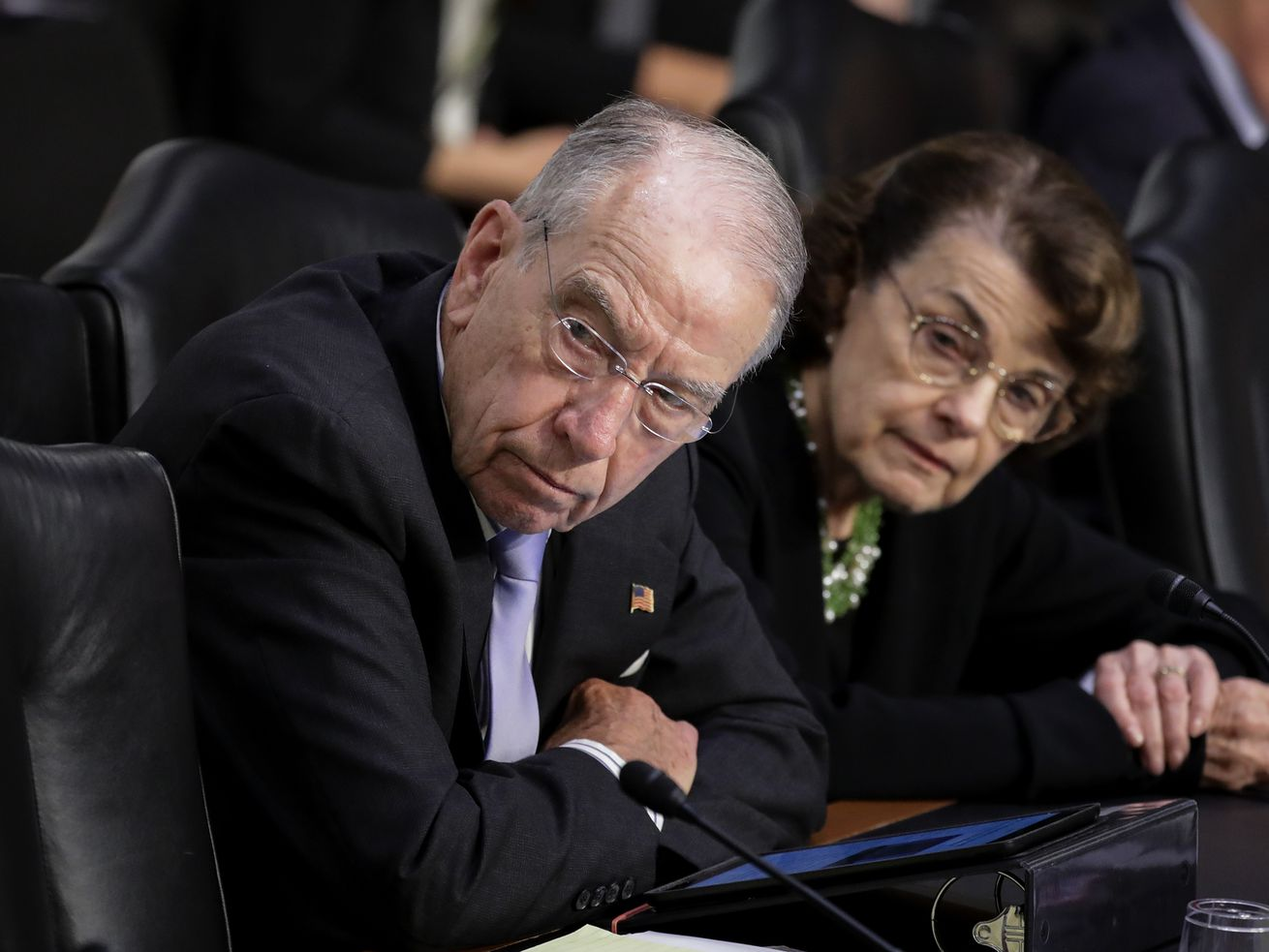 Sens. Chuck Grassley (R-IA) and Dianne Feinstein (D-CA) listen as Supreme Court nominee Brett Kavanaugh testifies before the Senate Judiciary Committee.