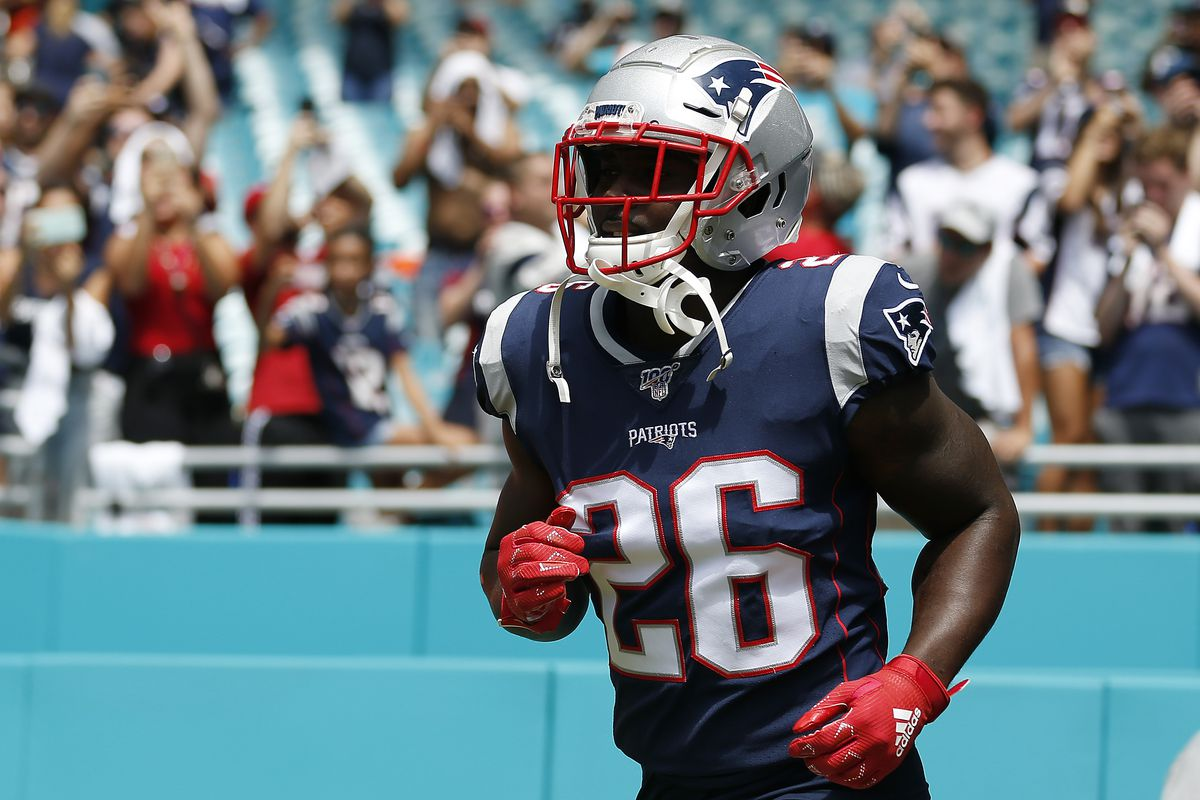 Sony Michel of the New England Patriots takes the field prior to the game between the Miami Dolphins and the New England Patriots at Hard Rock Stadium on September 15, 2019 in Miami, Florida.
