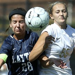 Layton's Camille Siddoway (28) and Davis' Annie Haycock (55) compete for the ball at Layton High School in Layton on Thursday, Aug. 27, 2020.