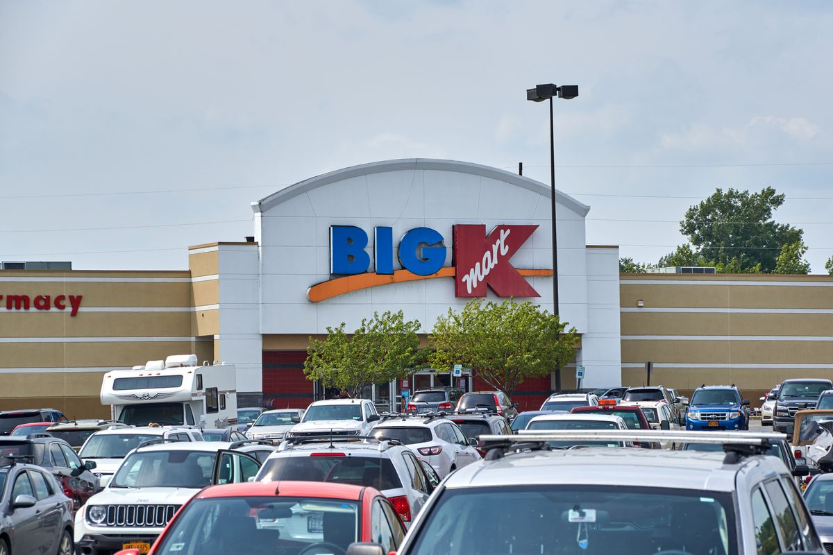 """A """"Big Kmart"""" store with a car-filled parking lot."""