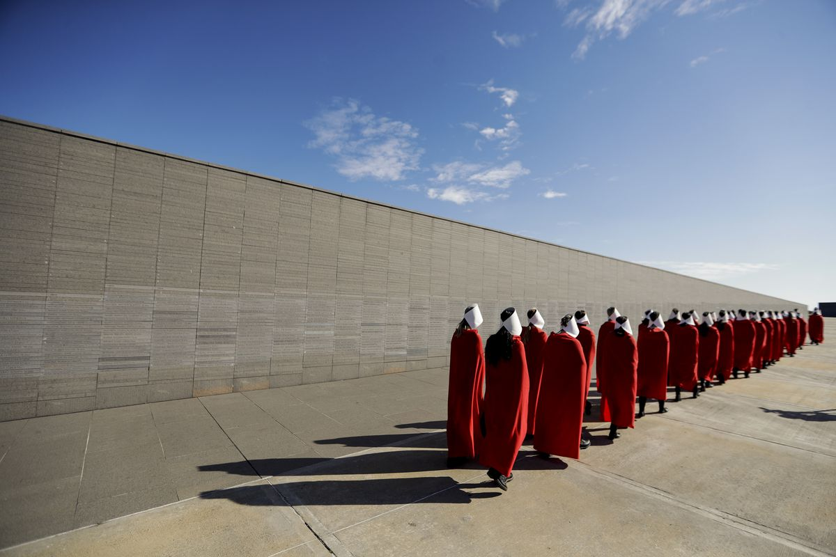 Auguest 8: Pro-choice activists in favor of decriminalizing abortion wear costumes from the Handmaid's Tale as they march through Remembrance Park, created to honor the victims of state terrorism and lists the names of those who disappeared during Argenti