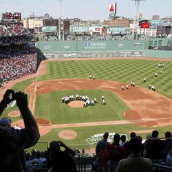Former Boston Red Sox players, managers and coaches walk one-by-one onto the field during ceremonies to celebrate the 100th anniversary of Fenway Park before a baseball game between the New York Yankees and the Boston Red Sox in Boston, Friday, April 20, 2012.