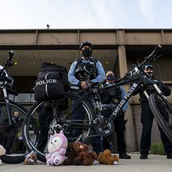Stuffed animals are left at the tires of a Chicago police officers bikes, which are being used as a shield to prevent activists from getting closer to the Chicago Police Training Academy, Friday, April 30, 2021.