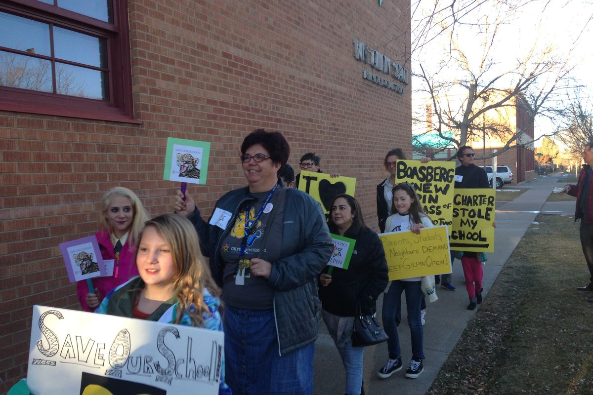 Supporters of Gilpin Montessori School march to a school board meeting Thursday.