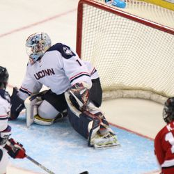 UConn's Tanner Creel (1) deflects the shot to the corner.