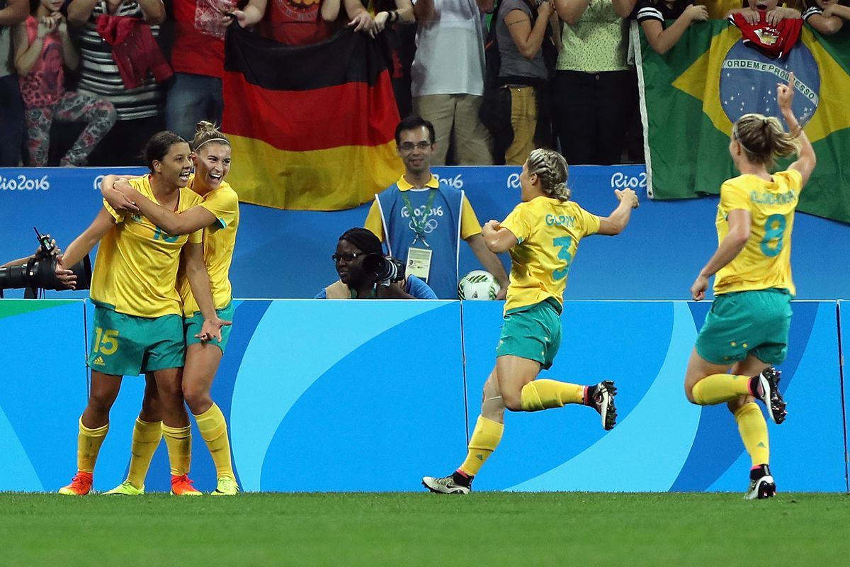 Sam Kerr and the Australian Women's National Team celebrate after Kerr's goal, the first for the team in the 2016 Olympics