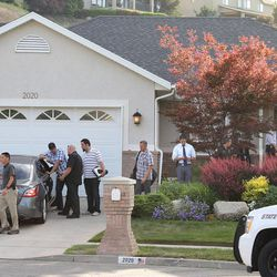 The FBI and Utah Department of Public Safety execute a search warrant at the house of former Attorney General Mark Shurtleff on Monday, June 2, 2014, in Sandy. A search also took place at former Attorney General John Swallow's home.