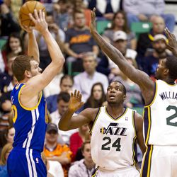 Jazz forwards Paul Millsap (24) and Marvin Williams (2) play defense on Warriors forward David Lee (10) during the first half of the NBA basketball game between the Utah Jazz and the Golden State Warriors at Energy Solutions Arena, Wednesday, Dec. 26, 2012.