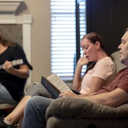 Andy Hogue sings a hymn during a church service in his home in Leander, Texas, on Sept. 6, 2020.