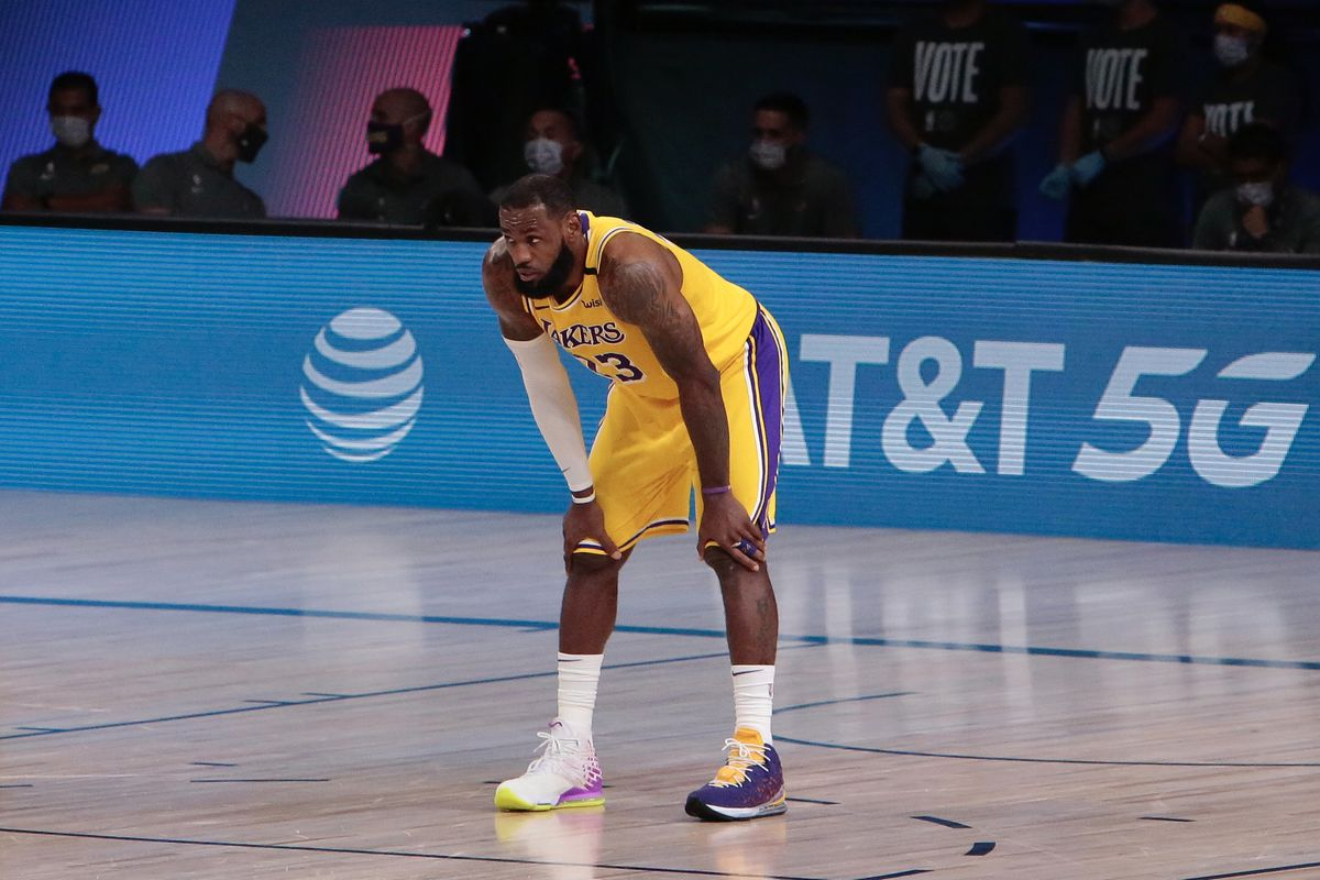 LeBron James of the Los Angeles Lakers looks on in the game against the Denver Nuggets in Game four of the Western Conference Finals of the 2020 Playoffs as part of the NBA Restart 2020 on September 24, 2020 at AdventHealth Arena at ESPN Wide World of Sports Complex in Orlando, Florida.
