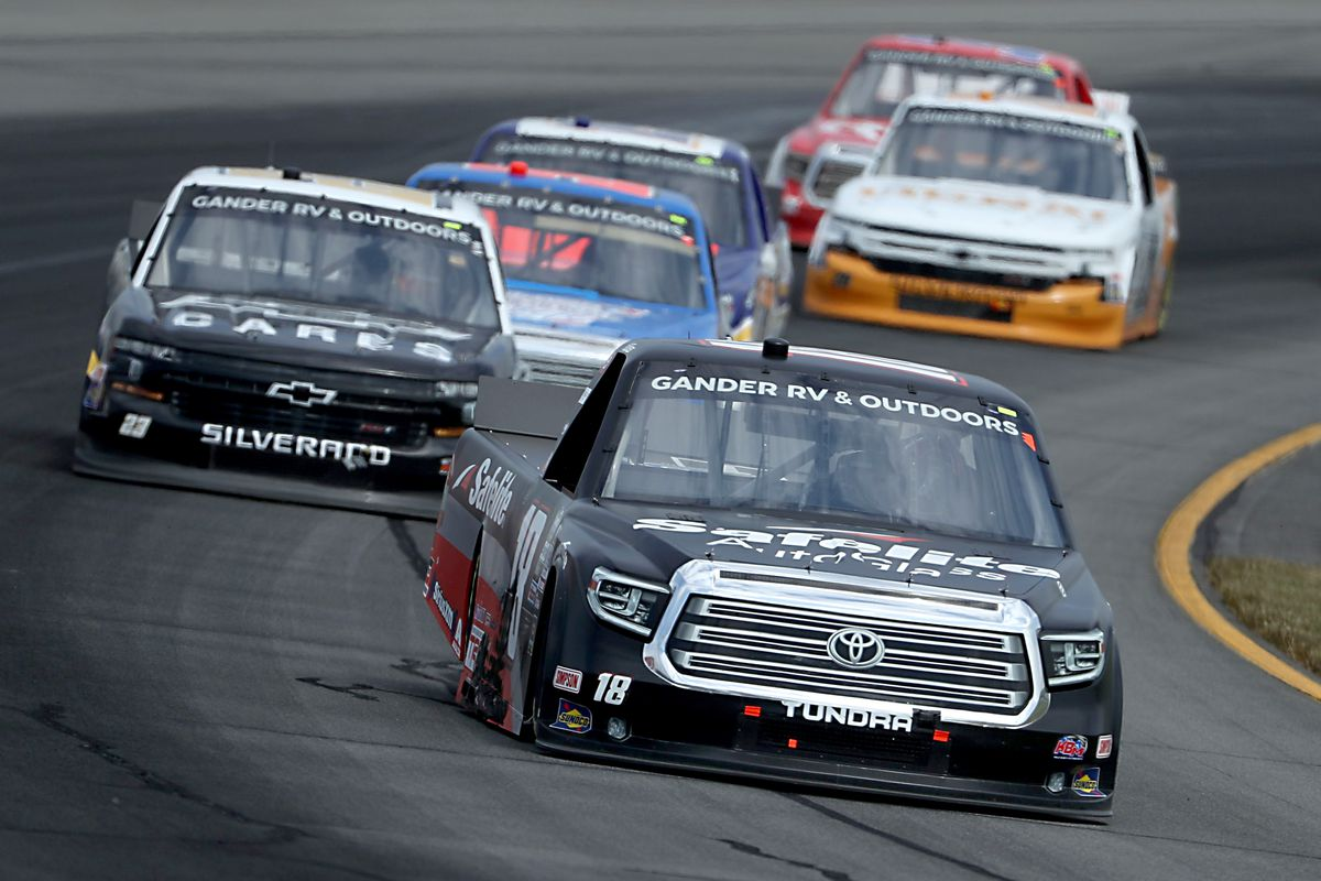 Christian Eckes, driver of the #18 Safelite AutoGlass Toyota, leads a pack of trucks during the NASCAR Gander RV & Outdoors Truck Series Pocono Organics 150 to benefit Farm Aid at Pocono Raceway on June 28, 2020 in Long Pond, Pennsylvania.