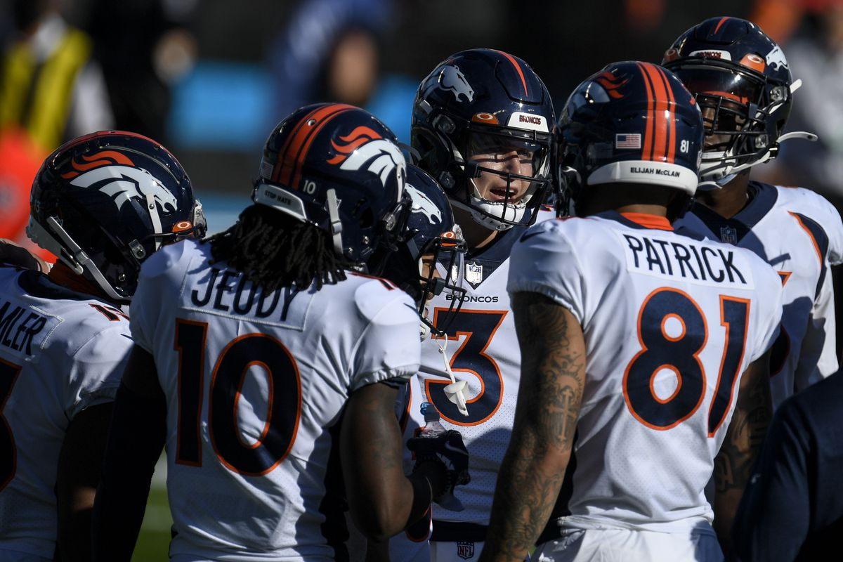 Drew Lock (3) of the Denver Broncos huddles the offensive unit during the first half of play against the Carolina Panthers at Bank of America Stadium on Sunday, December 13, 2020.