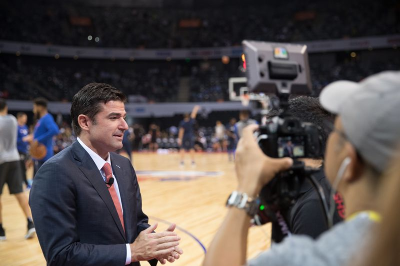 Philadelphia 76ers CEO Scott O'Neil speaks in front of a video camera before a 76ers game.
