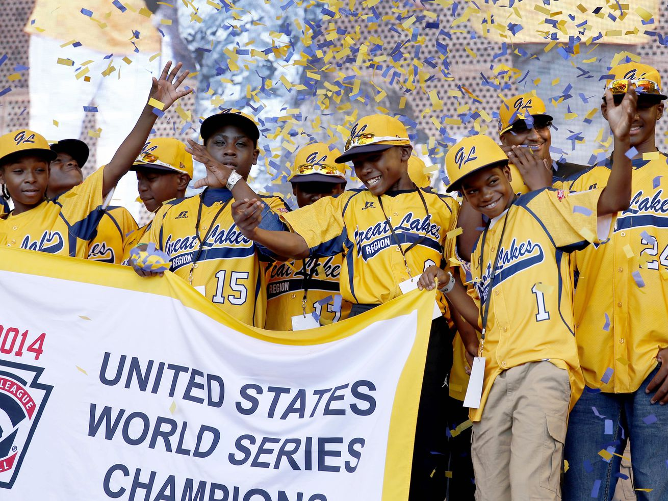 Members of the Jackie Robinson West All Stars Little League baseball team are shown at an August 2014 rally celebrating the team's U.S. Little League Championship. Little League International later stripped the team of that title after an investigation th