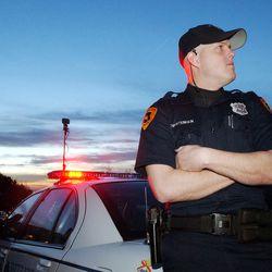 SLC officer Derek Christensen guards the Smart family home  after Elizabeth Smart was found March 12, 2003.