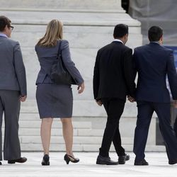 California's Proposition 8 plaintiffs, from left, Kris Perry, Sandy Stier, Paul Katami, and Jeff Zarrillo walk into the Supreme Court in Washington, Monday, June 24, 2013.