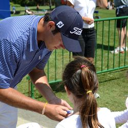 Clemson's Corbin Mills signs autographs after finishing up at the driving range Tuesday afternoon, April 10, 2012, for the RBC Heritage golf tournament, which begins Thursday at Harbour Town Golf Links in Hilton Head Island, S.C.