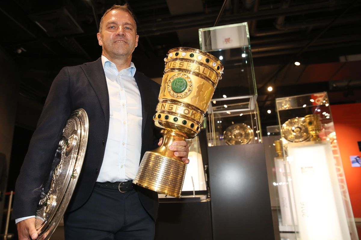Hans-Dieter Flick Hands Over Championship And DFB Cup Trophy To FCB Erlebniswelt