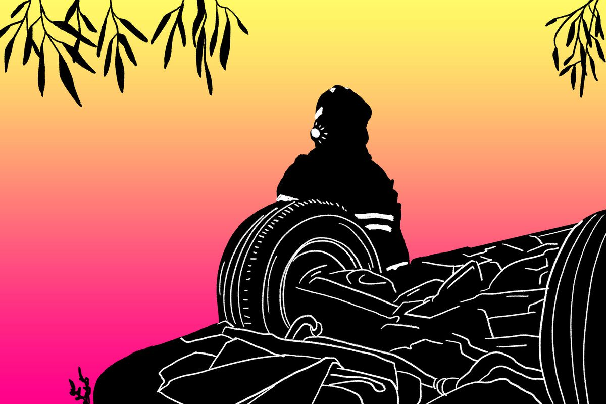 A silhouette of a firefighter standing in front of an overturned car