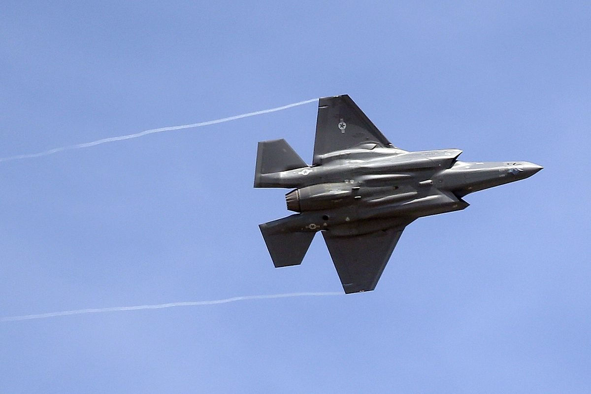 FILE - In this Sept. 2, 2015, file photo, an F-35 jet flies over its new operational base at Hill Air Force Base, in northern Utah.