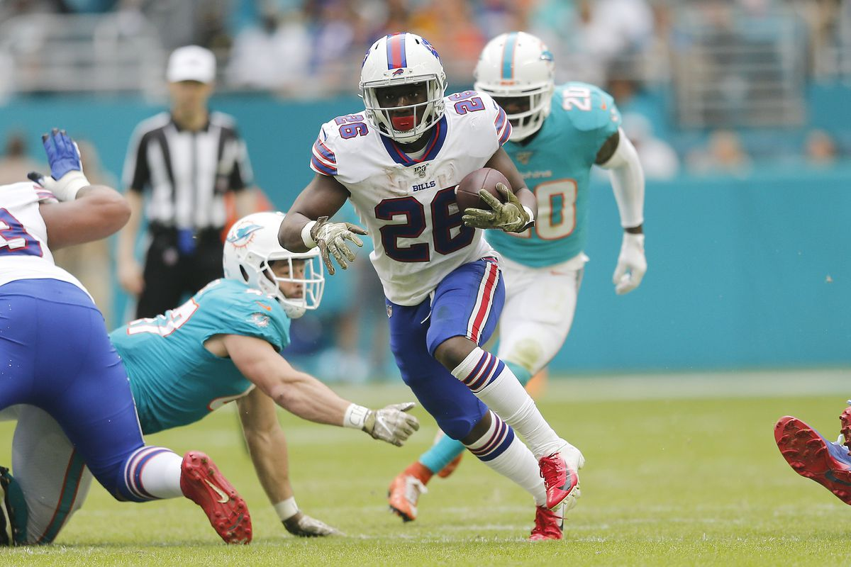 Devin Singletary of the Buffalo Bills runs with the ball against the Miami Dolphins during the second quarter at Hard Rock Stadium on November 17, 2019 in Miami, Florida.