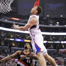Los Angeles Clippers forward Blake Griffin, right, dunks over Portland Trail Blazers center Kurt Thomas during the first half of their NBA basketball game, Friday, March 30, 2012, in Los Angeles. (AP Photo/Mark J. Terrill)