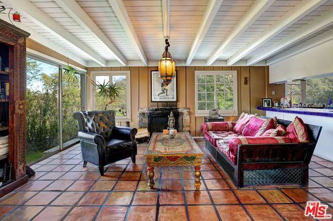 Living room with tile floor and sliding glass doors