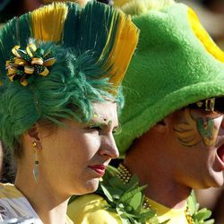 Oregon fans wear colorful garb as they cheer for their team during the first half of its NCAA college football game against Fresno State in Eugene, Ore., Saturday, Sept. 8, 2012.