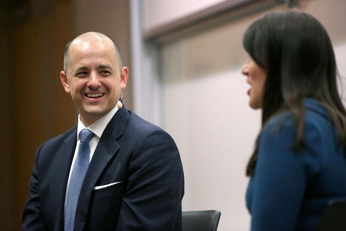 FILE - Evan McMullin speaks to students with political science professor Jessica Preece at BYU in Provo on Tuesday, March 28, 2017.  McMullin would beat Sen. Orrin Hatch in a head-to-head matchup for the U.S. Senate, a new poll shows.