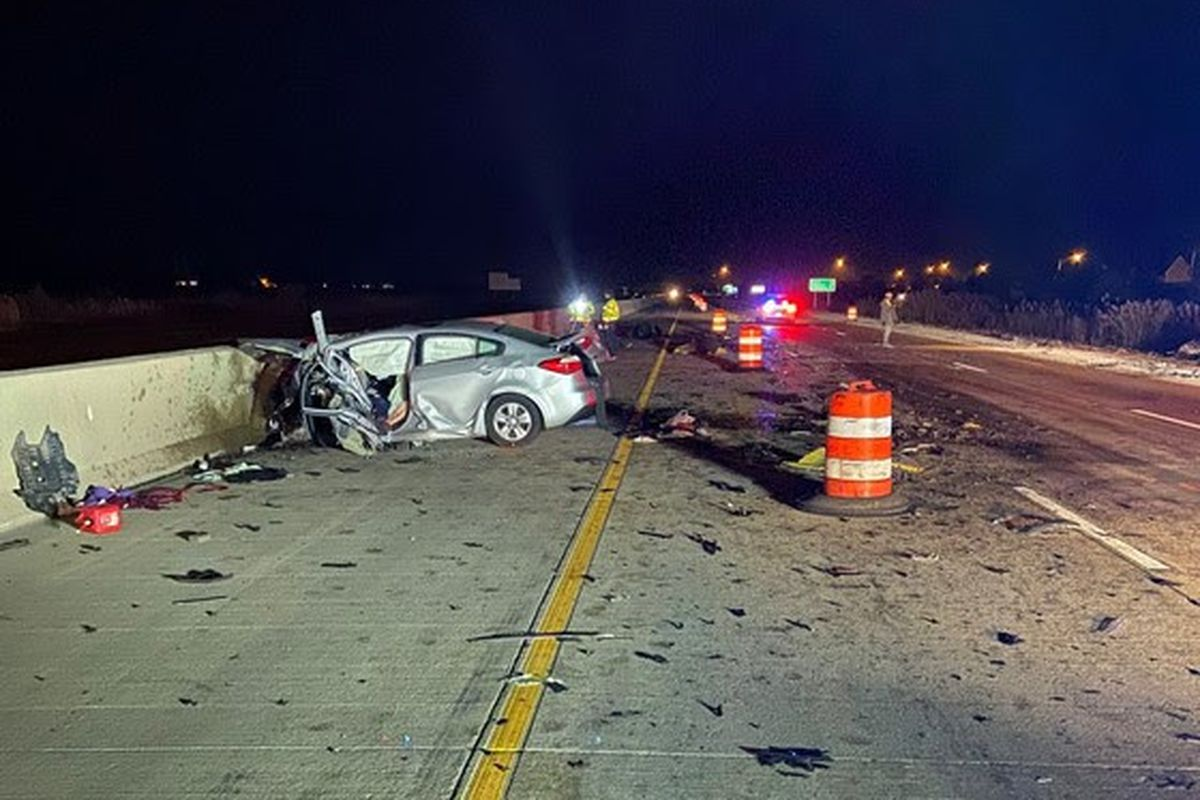 Indiana State Police investigate the wreckage of a crash that killed two people Nov. 10, 2019, on Interstate 65 in Crown Point, Indiana.