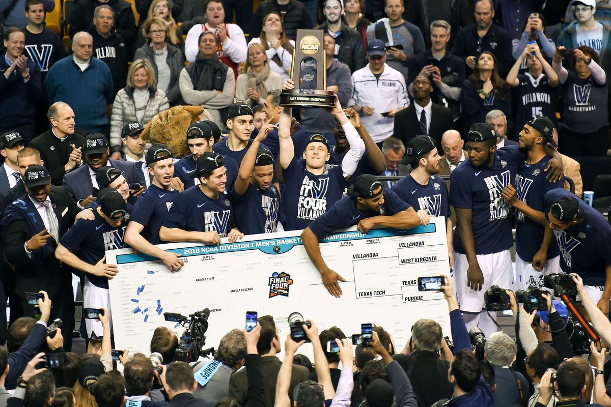 The Villanova Wildcats pose for a team picture in front of a NCAA Bracket after defeating the Texas Tech Red Raiders in the championship game of the East regional of the 2018 NCAA Tournament at the TD Garden.