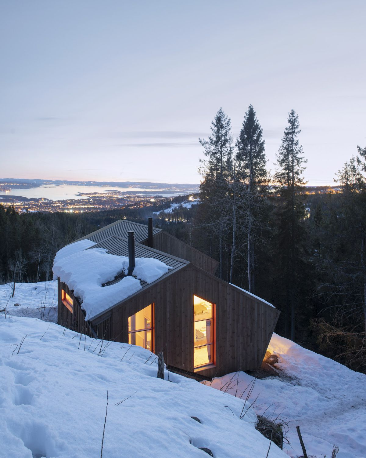 Timber home in snow