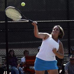 Kelsey Almony of St. Joseph returns the ball against Arie and Amanda Naylor (not pictured) in the State 2A Tennis first seed doubles tournament at Liberty Park in Salt Lake City Saturday, Sept. 29, 2012.