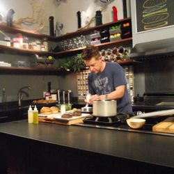 Host Chef Richard Blais measuring out ingredients for his scientifically engineered burger condiments.