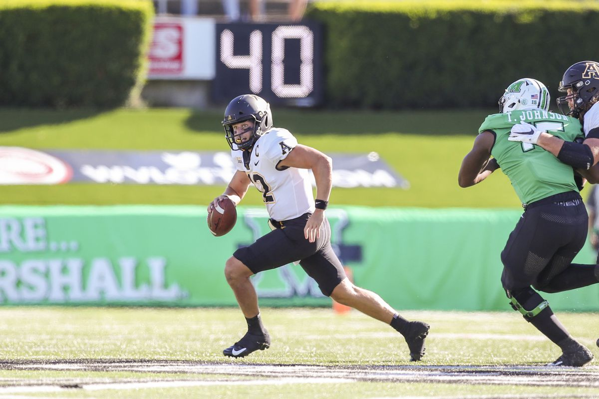Appalachian State Mountaineers quarterback Zac Thomas (12) runs out of the pocket during the second quarter against the Marshall Thundering Herd at Joan C. Edwards Stadium. Mandatory Credit: Ben Queen